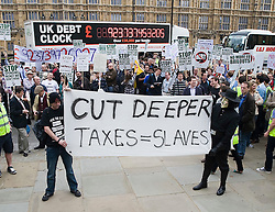 © licensed to London News Pictures. 14/05/2011. London, UK. A bus showing the national debt passes by The Rally Against Debt held in Westminster. London today (14/05/2011). Organisers of the pro-cuts demonstration include the Taxpayers' Alliance group. Please see special instructions for usage rates. Photo credit should read Ben Cawthra/LNP