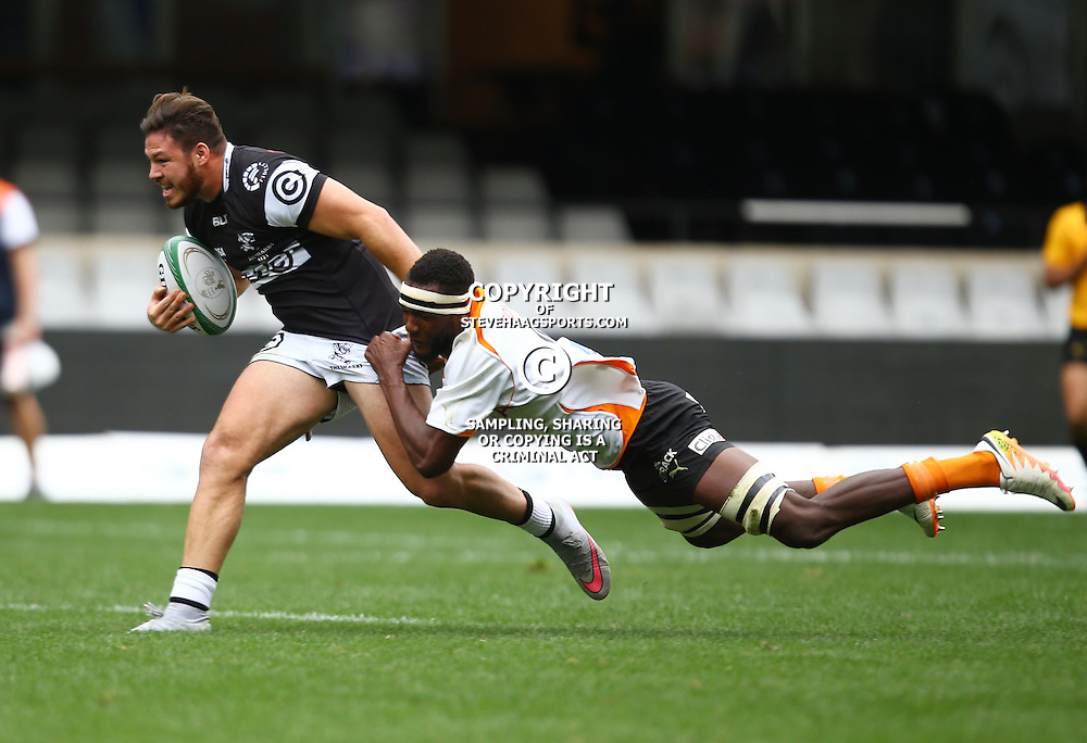 DURBAN, SOUTH AFRICA - SEPTEMBER 10: Marius Louw of the Cell C Sharks Under 21's is tackled by Gopolang Molefe of the Toyota FS Cheetahs U21 during the Currie Cup U21 match between the Sharks and Free State at Growthpoint Kings Park on September 10, 2016 in Durban, South Africa. (Photo by Steve Haag/Gallo Images)