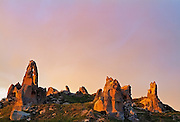 Erdoded Ruins are being lit up by the sunset in Cappadocia, Turkey