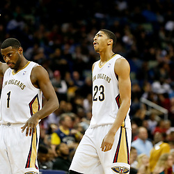 Dec 30, 2013; New Orleans, LA, USA; New Orleans Pelicans point guard Tyreke Evans (1) and New Orleans Pelicans power forward Anthony Davis (23) react after a score during the second half of a game against the Portland Trail Blazers at the New Orleans Arena. The Pelicans defeated the Trail Blazers 110-108. Mandatory Credit: Derick E. Hingle-USA TODAY Sports