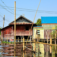 Homes Along Canals in Bangkok, Thailand <br />