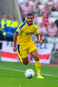 Kwesi Appiah (#9) of AFC Wimbledon during the EFL Sky Bet League 1 match between Sunderland and AFC Wimbledon at the Stadium Of Light, Sunderland, England on 24 August 2019.