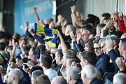 AFC Wimbledon fan waving scarf after AFC Wimbledon defender Terell Thomas (6) goal during the EFL Sky Bet League 1 match between AFC Wimbledon and Portsmouth at the Cherry Red Records Stadium, Kingston, England on 19 October 2019.