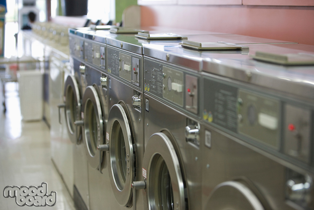 Row of washing machines in launderette
