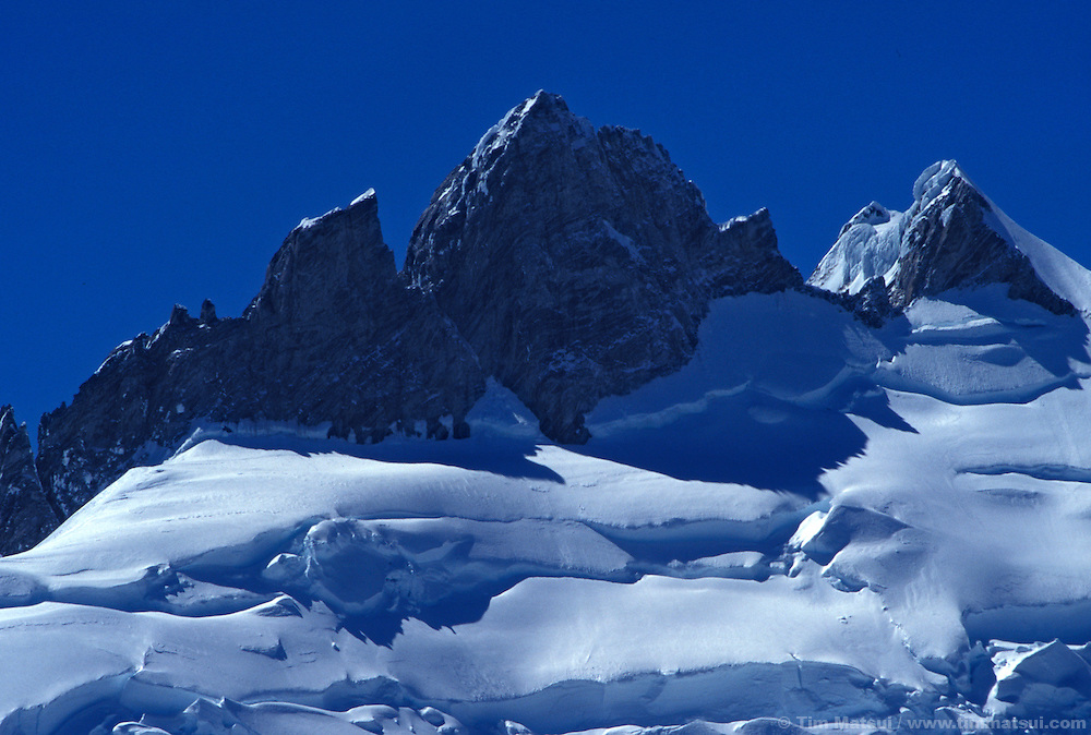 The summit pyramid of Mt. Waddington and the upper reaches of the Bravo Glacier. British Columbia.