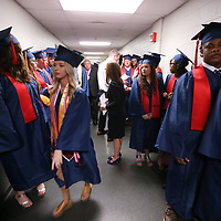 Nettleton High School grduates rush to get ini line before Saturday's graduation at BancorpSouth Arena.