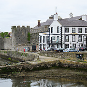 The Anglesey Pub nestled against the walls of Caernarfon Castle in northwest Wales. A castle originally stood on the site dating back to the late 11th century, but in the late 13th century King Edward I commissioned a new structure that stands to this day. It has distinctive towers and is one of the best preserved of the series of castles Edward I commissioned.