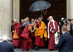 © Licensed to London News Pictures. 14/05/2012. City of London, UK The Dalai Lama (C with medal) leaves St Paul's Cathedral today 14 may 2012 after being presented with the £1.1m Templeton annual prize in his first visit to the Cathedral. The award is for a living person who has 'made an exceptional contribution to affirming the spiritual dimension of life'.. Photo credit : Stephen Simpson/LNP