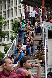 June 15, 2017 - Dhaka, Dhaka, Bangladesh - June 15, 2017 Dhaka, Bangladesh - Bangladeshi cricket lover cheers as they watch the ICC Champions Trophy cricket match between Bangladesh and India broadcast on a screen in a street in Dhaka. (Credit Image: © K M Asad via ZUMA Wire)