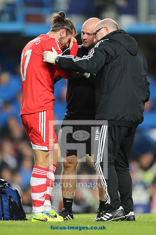 Picture by Richard Calver/Focus Images Ltd +447792 981244<br /> 01/12/2013<br /> Pablo Daniel Osvaldo of Southampton receives treatment for a head injury during the Barclays Premier League match against Chelsea at Stamford Bridge, London.
