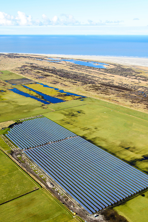 Nederland, Friesland, Ameland, 28-02-2016; zonnepark op Ameland, gelegen naast vliegveld van Ballum. Zonnepark Ameland is het grootste van Nederland.<br /> Solar park at Ameland, located next to Airport Ballum. Solar Park Ameland is the largest in the Netherlands.<br /> luchtfoto (toeslag op standard tarieven);<br /> aerial photo (additional fee required);<br /> copyright foto/photo Siebe Swart