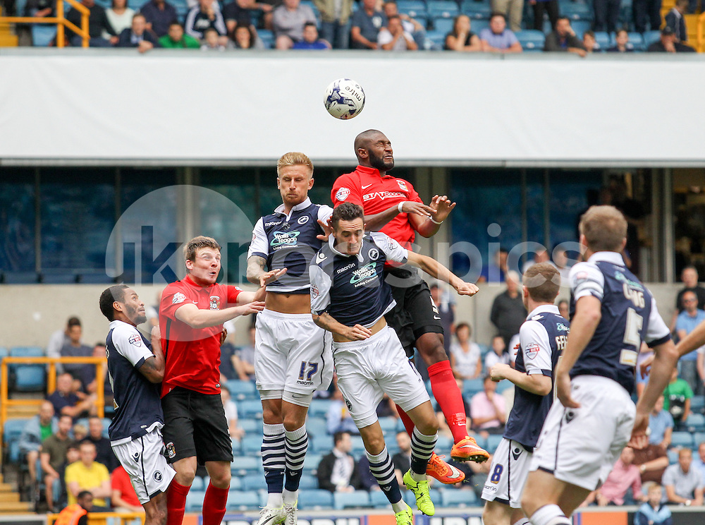 Reda Johnson of Coventry City challenges for a header with Byron Webster of Millwall during the Sky Bet League 1 match between Millwall and Coventry City at The Den, London, England on 15 August 2015. Photo by Edmund  Boyden.