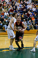 1/13/2006: Casey Fisher of the Northwest Nazarene University Crusaders heads to the hoop in the Alaska Anchorage comeback victory over Northwest Nazarene, 60-57, in men?s basketball action at the Wells Fargo Sports Complex on Saturday.