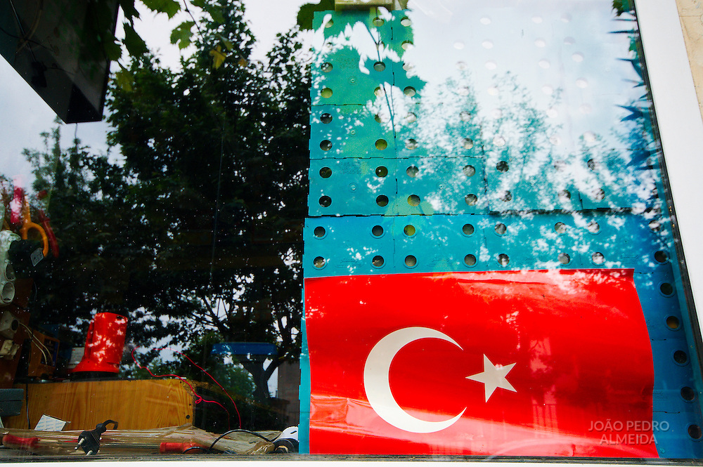 The omnipresent Turkish flag seen at the window of a closed store