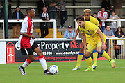 AFC Wimbledon midfielder Chris Whelpdale (11) watches Woking midfilder Charles Banya during the Pre-Season Friendly match between Woking and AFC Wimbledon at the Kingfield Stadium, Woking, United Kingdom on 29 July 2016. Photo by Stuart Butcher.