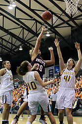 19 March 2010: Carrie Snikkers gets a shot from between Michelle Ketcham and Amy Woods. The Flying Dutch of Hope College defeat the Yellowjackets of the University of Rochester in the semi-final round of the Division 3 Women's Basketball Championship by a score of 86-75 at the Shirk Center at Illinois Wesleyan in Bloomington Illinois.