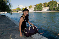 Michelle Lai, Mischa handbags owner, founder and designer photographed with her Overnighter in Paris, France.