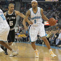 29 March 2009: New Orleans Hornets guard Morris Peterson (9) drives past San Antonio Spurs guard Tony Parker (9) during a 90-86 victory by the New Orleans Hornets over Southwestern Division rivals the San Antonio Spurs at the New Orleans Arena in New Orleans, Louisiana.