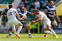 Bath Outside Centre Jonathan Joseph hands off Saracens Flanker Jacques Burger - Photo mandatory by-line: Rogan Thomson/JMP - 07966 386802 - 30/05/2015 - SPORT - RUGBY UNION - London, England - Twickenham Stadium - Bath Rugby v Saracens - 2015 Aviva Premiership Final.
