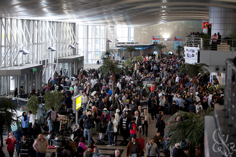 Thousands of travelers wait at the Cairo International airport for word of available flights out of the country January 30, 2011 in Cairo, Egypt. Many of the travelers included Egyptians desperate to flee the country following nearly a week of ongoing unrest that threatens to bring down President Hosni Mubarak's regime.