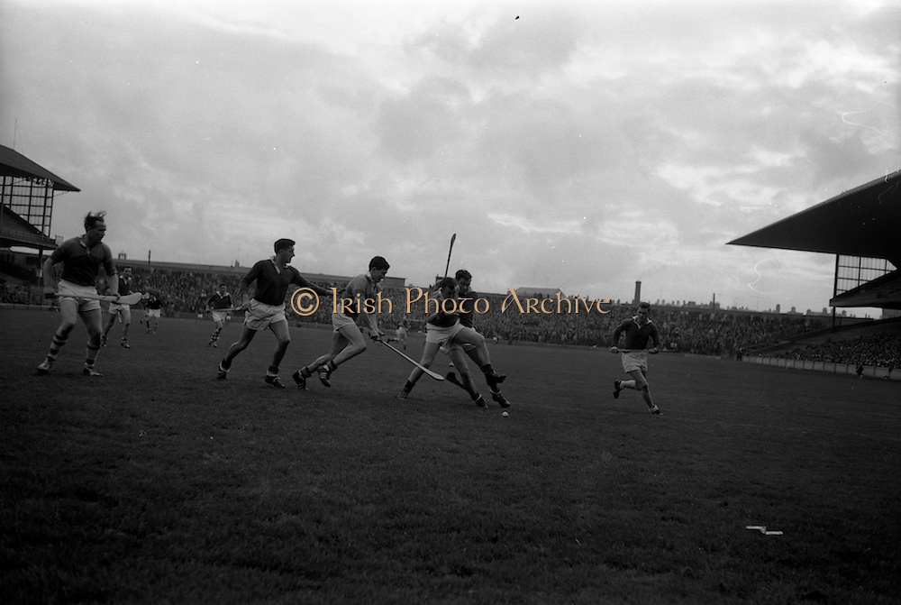16/10/1966<br /> 10/16/1966<br /> 16 October 1966<br /> Oireachtas Senior Semi-Final: Cork v Wexford at Croke Park, Dublin.<br /> Cork full back, Tom O'Donoghue (left) watches the outcome of his teammate, P. Doolan clashing with Wexford's S. Whelan.