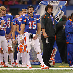 Jan 01, 2010; New Orleans, LA, USA; Florida Gators quarterback Tim Tebow (15) on the sideline during the second half against the Cincinnati Bearcats during the 2010 Sugar Bowl at the Louisiana Superdome.  Mandatory Credit: Derick E. Hingle-US PRESSWIRE.