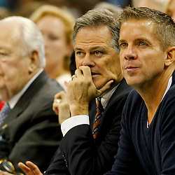 Feb 6, 2013; New Orleans, LA, USA; New Orleans Saints head coach Sean Payton watches courtside with general manager Mickey Loomis and owner Tom Benson during the second quarter of a game between the New Orleans Hornets and the Phoenix Suns at the New Orleans Arena. Mandatory Credit: Derick E. Hingle-USA TODAY Sports