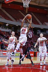 29 January 2017: Viria Livingston takes an inside shot contested by Rishonda Napier during an College Missouri Valley Conference Women's Basketball game between Illinois State University Redbirds the Salukis of Southern Illinois at Redbird Arena in Normal Illinois.