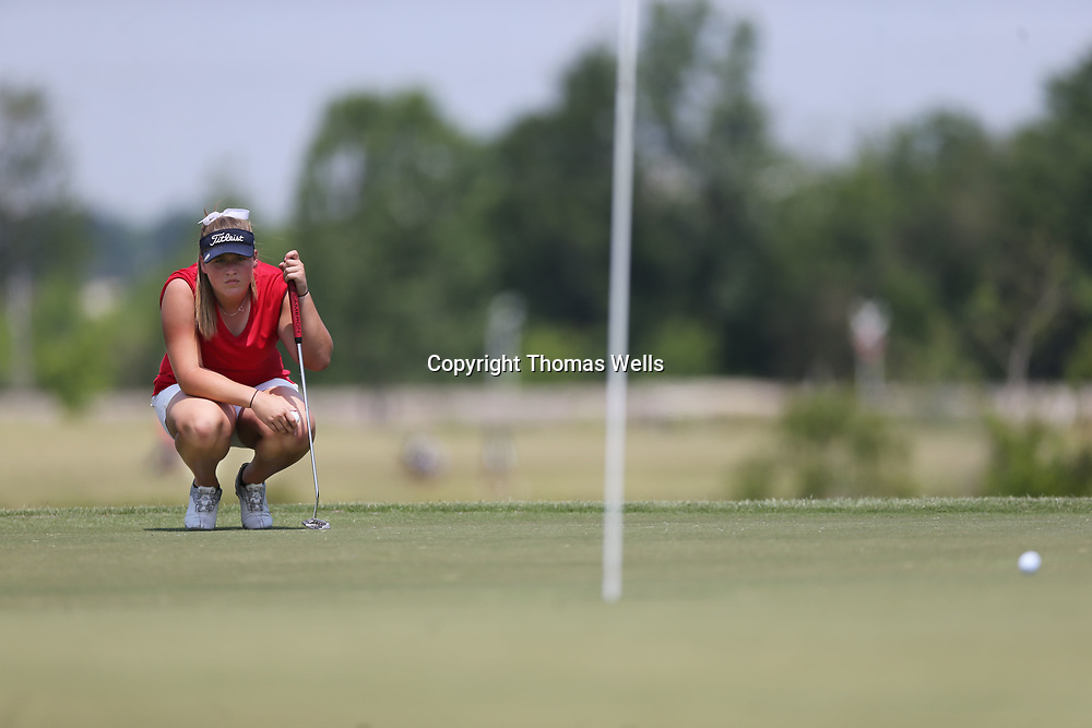 Nettleton's Riley Mayhew looks at her putting line on the par 5 sixth at Big Oaks on Tuesday.