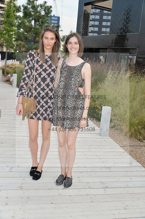 Left to right, CHARLOTTE WIGGINS and SAM ROLLINSON at a reception hosted by Eco World Ballymore and the English National Ballet to celebrate their partnership at London City Island, Orchard Place, London E14 on 1st July 2015