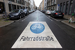 View of cycle street in Linienstrasse in Mitte Berlin, with cycleway sign painted onto road, Germany.