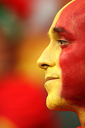 A Spain fan with a painted face
