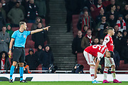 Sandro Scharer (Referee) backs away and call two players over during the Europa League match between Arsenal and Standard Liege at the Emirates Stadium, London, England on 3 October 2019.