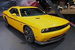 08 February 2012:  2012 Dodge Challenger SRT8 Yellow Jacket with 392 Hemi. The Charger SRT8 comes with a new 6.4 liter HEMI V8 delivering more horsepower and torque than the 6.1 liter HEMI V8 it replaces. Estimated power ratings for the 2012 Dodge Charger SRT8 are 465 horsepower and 569Nm of torque. Specific horsepower and torque numbers will be announced closer to the vehicle introduction. The standard paddle-shift technology joins the standard AutoStick on the floor shifter. Both are mated to the W5A580 five-speed automatic transmission. Chicago Auto Show, Chicago Automobile Trade Association (CATA), McCormick Place, Chicago Illinois