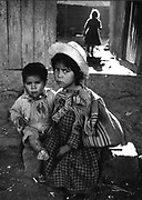 Outside of Lima Peru.  Little girl is what Margaret Mead called the child mother.  Works to support the family.  Little girl is taking care of the little boy for the day.  Mead was very interested in child nurses.