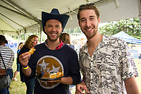 Carson and Matt wash down lunch with a Jalapeno Lime Pale Ale from Lone Wolfe Brewing Co. during Gunstock Mountain's Brew and BBQ Fest on Saturday.  (Karen Bobotas/for the Laconia Daily Sun)