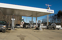 Vehicles filled the bays at Penguin Fuels on Route 106 in Loudon with some of the lowest gas prices posted in the area at $1.57.9/gallon for regular unleaded Sunday morning.  (Karen Bobotas/for the Laconia Daily Sun)