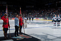 KELOWNA, CANADA - NOVEMBER 11: Jeff Piatelli sings before the national anthem between two RCMP officers standing at attention on the ice for Remembrance Day ceremonies at the Kelowna Rockets against the Red Deer Rebels on November 11, 2017 at Prospera Place in Kelowna, British Columbia, Canada.  (Photo by Marissa Baecker/Shoot the Breeze)  *** Local Caption ***