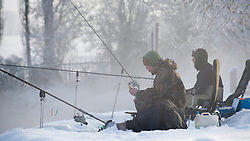 © under license to London News Pictures.  19/12/2010 Locals fishing on the River Avon with freshly fallen snow around them in Worcestershire today (19/12/2010). Snow has fallen over much of the UK in the past few days. Picture credit should read: David Hedges/LNP
