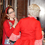 """The Claus' new assistant Penelope (left, aka Jenna Rebbin Shaw) talks with Mrs. Claus during Mayhem & Mystery's production of """"I'll Be Home Shopping for Christmas"""" at the Spaghetti Warehouse in downtown Dayton, Monday, November 9, 2009."""