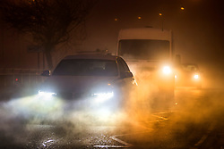 © Licensed to London News Pictures. 07/02/2020. Leeds UK. People make their way to work this morning in thick fog in Leeds, Yorkshire. Photo credit: Andrew McCaren/LNP