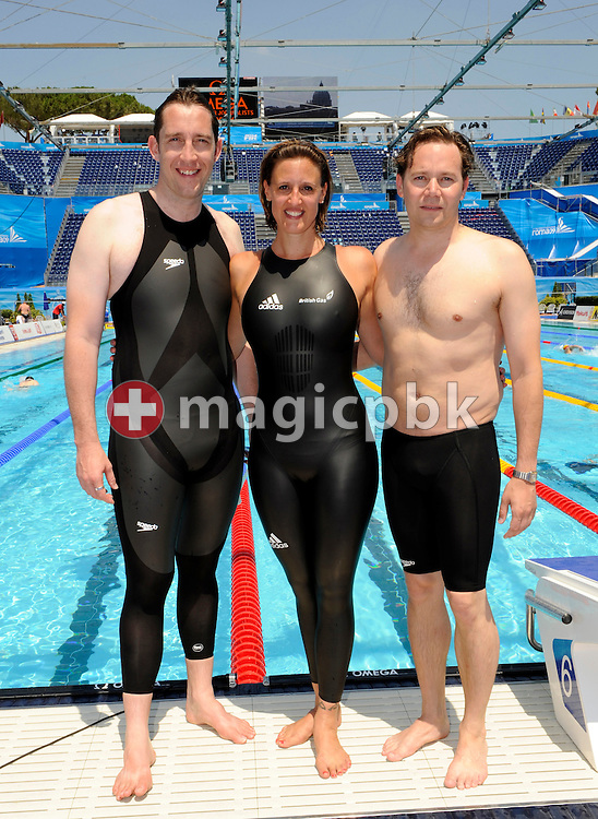 (L-R) Former British swimmers Stephen Parry, wearing a Speedo LZR Racer suit with panels of non-permeable material, Karen Pickering, wearing a new adidas suit made of non-permeable material, and James Hickman, wearing a textile jammer, pose poolside the 13th FINA World Championships at the Foro Italico complex in Rome, Italy, Thursday, July 30, 2009. FINA the world swimming body decided to go back to textile swimsuits by 2010. (Photo by Patrick B. Kraemer / MAGICPBK)