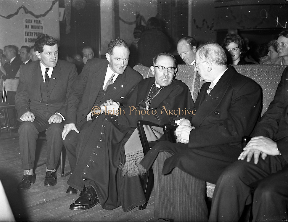 09/04/1961<br /> 04/09/1961<br /> 09 April 1961<br /> Opening of Thurles Drama Festival at Premier Hall Thurles, Co. Tipperary, organised by Muintir na Tíre and Gael Linn.  The Archbishop of Cashel Thomas Morris and President Eamonn de Valera (2nd and 3rd from right) chat in their seats before the show.