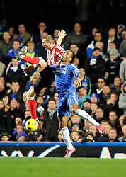 14.11.2010, Stamford Bridge, London, ENG, PL, FC Chelsea vs FC Sunderland, im Bild Michael Turner of Sunderland and Didier Drogba of Chelsea battle each other..Chelsea v Sunderland.English Premiership,.Stamford Bridge, London. UK. .14/11/10,. EXPA Pictures © 2010, PhotoCredit: EXPA/ IPS/ Sean Ryan +++++ ATTENTION - OUT OF ENGLAND/UK +++++