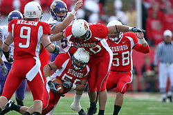27 October 2007:  Bill Hronec protects the ball on a special teams play. The Western Illinois Leathernecks beat up on the Illinois State Redbirds  27-14 at Hancock Stadium on the campus of Illinois State University in Normal Illinois.