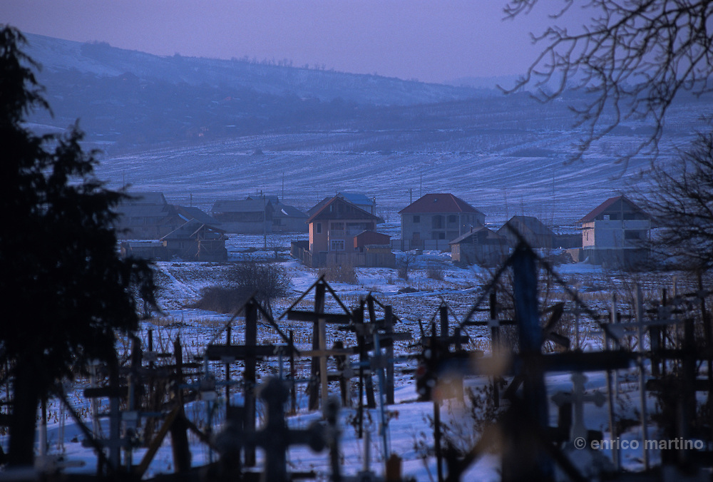 Faraoani village, Forrofalva in Hungarian, the csango cemetery. In the back the new landscape of the houses of csango migrated in other European countries.