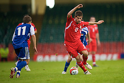 CARDIFF, WALES - Saturday, October 11, 2008: Wales' Ched Evans in action against Liechtenstein during the 2010 FIFA World Cup South Africa Qualifying Group 4 match at the Millennium Stadium. (Photo by David Rawcliffe/Propaganda)
