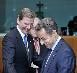 "Nicolas Sarkozy, France's president, right, shares a laugh with Guido Westerwelle, Germany's new foreign minister, during the European Union Summit at the EU headquarters in Brussels, Belgium, on Thursday, Oct. 29, 2009. European Union leaders are set for ""very difficult"" talks to overcome the Czech Republic's resistance to a new governing treaty designed to strengthen the EU's influence in world affairs, Reinfeldt said. (Photo © Jock Fistick)"