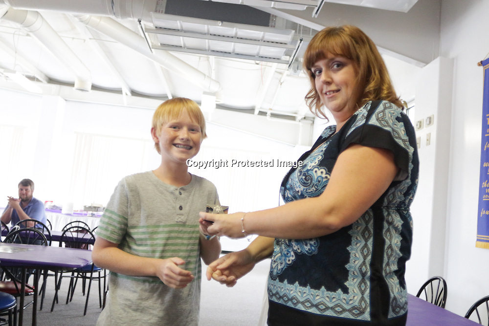 Brae Troutman accepts an award from Star News Editor Sherry Jones for the 15 Under 15 project Sunday September 14, 2014 at Jungle Rapids in Wilmington, N.C. (Jason A. Frizzelle)