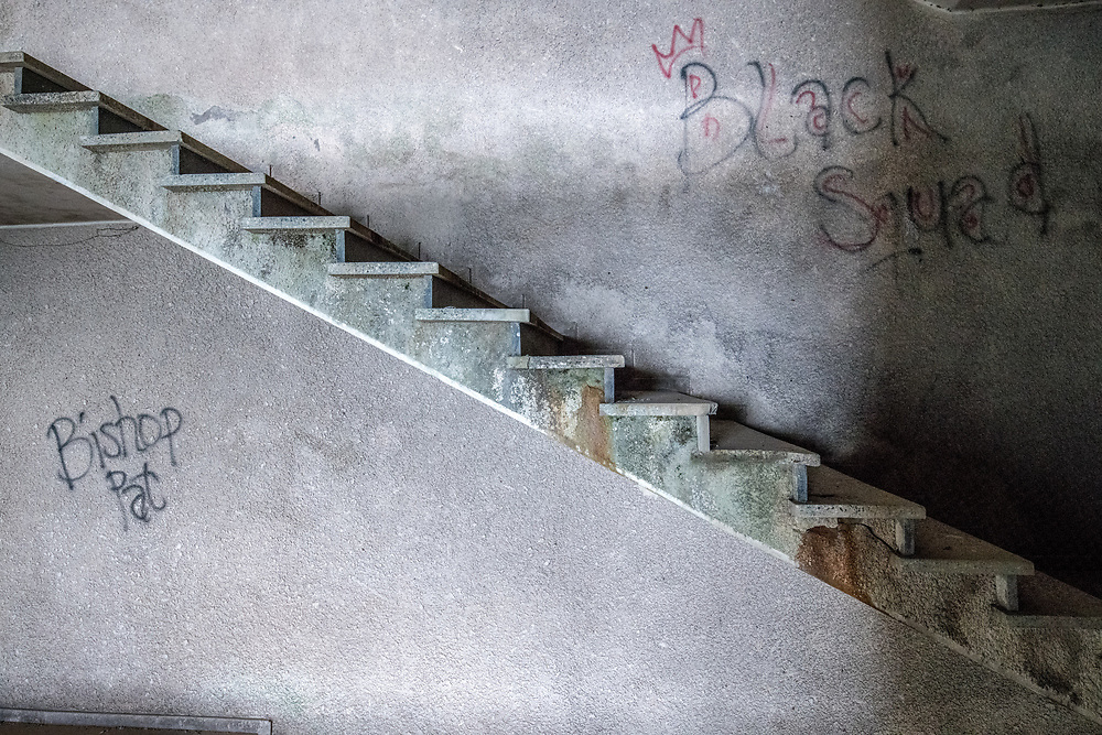 Graffiti on the walls alongside stairs of the abandoned Ducor Hotel, once the most prominent hotels in Monrovia, LiberiaMonrovia, Liberia